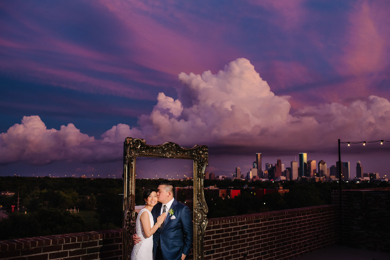 Wedding photo at 1111 Studemont venue with Houston Skyline and Sunset