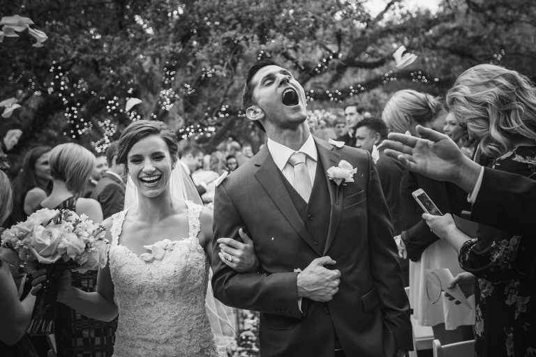 Flower Petal toss after ceremony at Cohen House at Rice University outdoor wedding