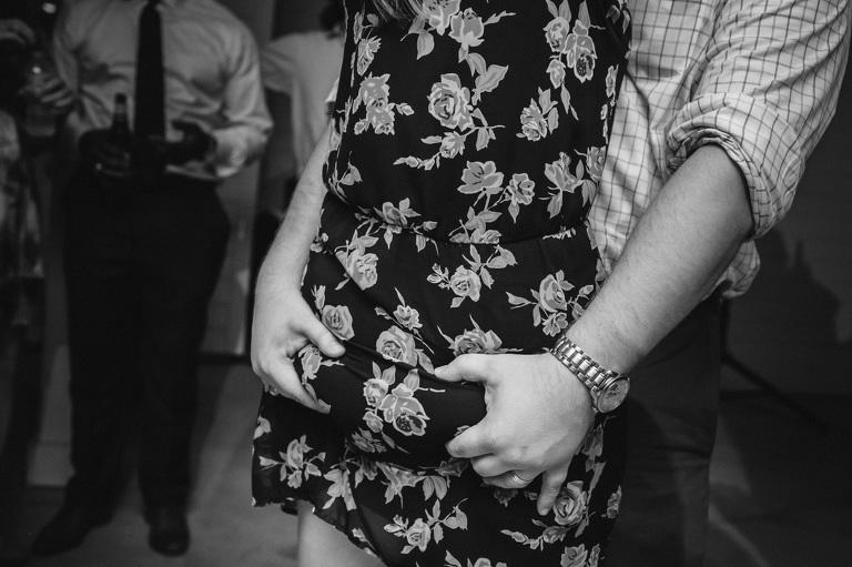 Guest grab butt at wedding reception dance