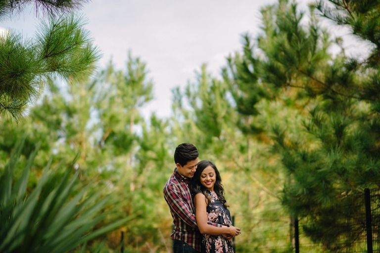 Engagement session at Hermann Park Centennial Gardens Houston Skyline Bayou Park
